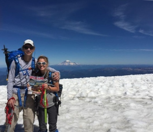 Hanna pictured with her dad on the summit of Mt. Adams holding the magazine
